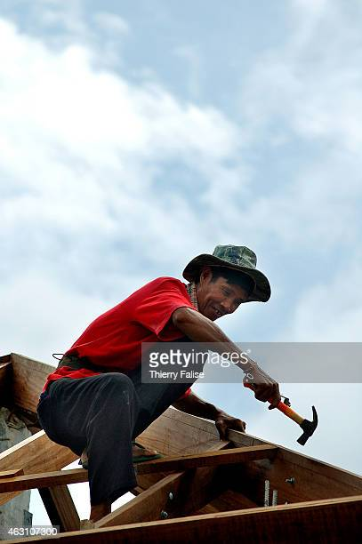 Burmese migrant at work on the construction of a resort devastated by the tsunami on Khuk Khak beach in Bang Niang village