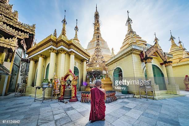 Burmese Monk Praying at Sule Pagoda Myanmar