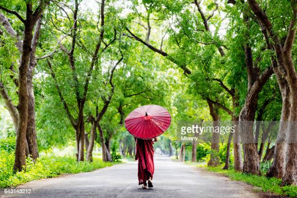 Burmese Monk Walking Along Green Alley Myanmar