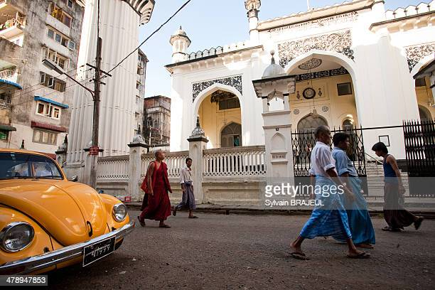 CONTENT] Burmese monks and muslims in front of a mosquee in the streets of Yangon also called Rangoon Myanmar aka Burma