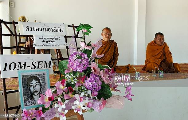 Burmese monks wait for a ceremony dedicated to the memory of a Burmese migrant worker who died in the tsunami IOM's Migrant Health Project helped to...