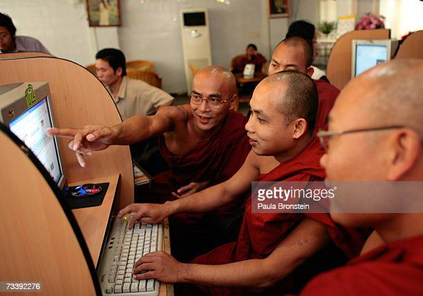 Burmese monks work on computers reading Buddhist websites at a local internet cafe February 22 2007 in Mandalay Myanmar The internet is strictly...