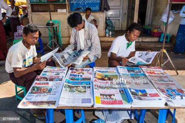 burmese news paper sellers - naypyidaw stock pictures, royalty-free photos & images