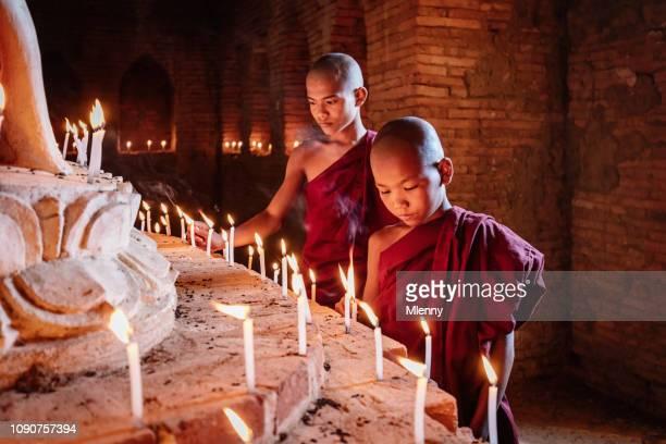 Burmese Novice Monks Lighting Candles Buddha Statue Myanmar