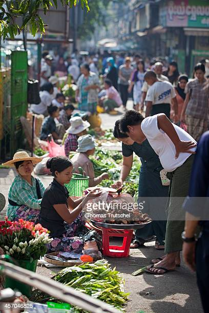 Burmese people at a market on April 30 in Yangon Burma Photo by Thomas Trutschel/Photothek via Getty Images