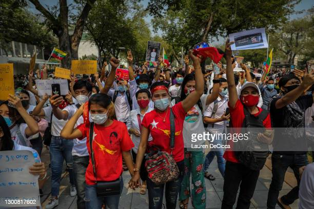 Burmese people protest against the coup in Myanmar in front of the United Nations headquarters on February 07, 2021 in Bangkok, Thailand. The United...