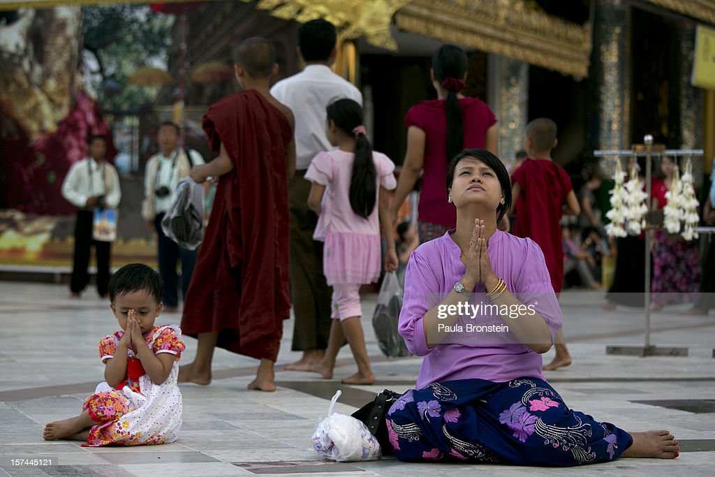 Burmese pray at the Shwedagon pagoda on November 30, 2012 in downtown Yangon, Myanmar. Business opportunities are expanding in the Southeast Asian country as it emerges from financial isolation. Import restrictions have been eased resulting in many new cars seen on the streets.