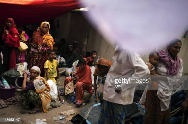 Burmese refugee from the Rohingya community a predominantly Muslim sect in Burma take refuge on a street near the United Nations High Commission for...