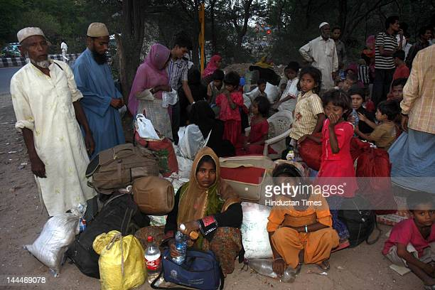 Burmese refugees wait for a status decision at Vasant Kunj on May 13 2012 in New Delhi India Around 2500 refugees from Myanmar's Northern Rakhine...