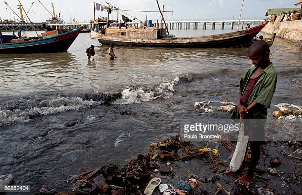 Burmese Rohingya boy waits for a fishign boat to come in so he can make small money carrying the fish to shore on May 5 2009 in Sittwe Arakan state...