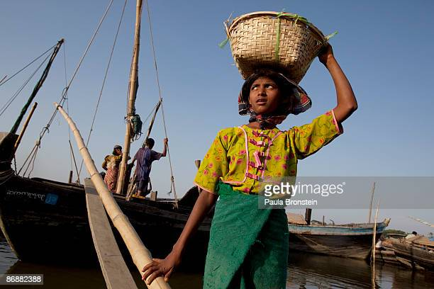 Burmese Rohingya laborer carries rocks from a boat used for a road project on May 4 2009 in Sittwe Arakan state Myanmar The Rohingya Muslim minority...