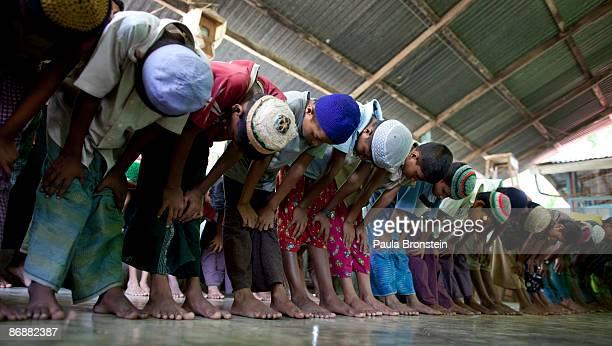Burmese Rohingya madrassa students pray at a local mosque on May 4 2009 in Sittwe Arakan state Myanmar The Rohingya Muslim minority live in Muslim...