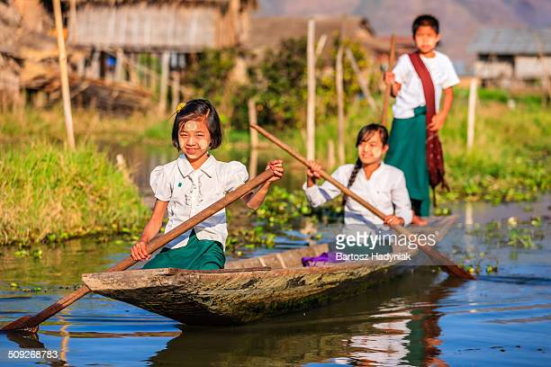 Burmese students on their way to school by boat