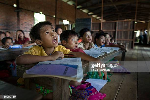 Burmese students recite during class at a small government run school December 14 2011 in Waw township Myanmar The education system is based on the...