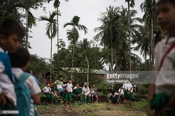 Burmese students take a break from classes in their village inside the planned Dawei SEZ on August 3 2015 in Mudu Myanmar The controversial...
