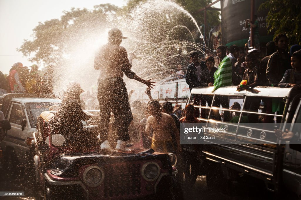 Burmese teenagers and children celebrate the Burmese New Year water festival, called Thingyan, near to the Mandalay palace on April 15, 2014 in Mandalay, Burma. Thingyan is a Buddhist festival celebrated during the four days leading up to the New Year.