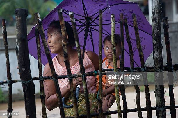 Burmese woman and her grandchild relax in a village near the planned Dawei SEZ on August 2 2015 in Bawar Village Myanmar The controversial...