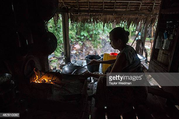 Burmese woman cooks lunch in her home near the Dawei SEZ on August 4 2015 in Pantininn Myanmar The controversial multibillion dollar Dawei special...