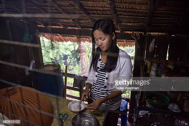 Burmese woman makes lunch in her home near the planned Dawei SEZ on August 4 2015 in Pantininn Myanmar The controversial multibillion dollar Dawei...