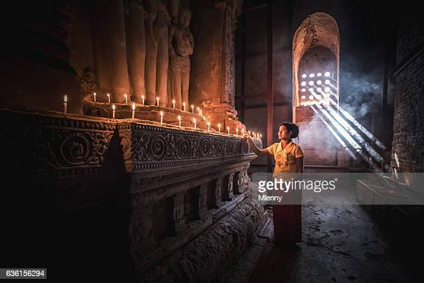 Burmese Woman Praying to Buddha Temple Pagoda Bagan Myanmar