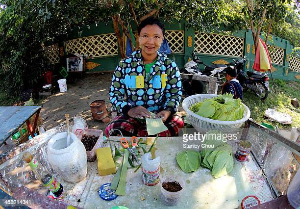 Burmese woman sells the traditional pinang leafs for chewing with the uses of the mixture of areca nuts and betel leafs at the nearby Zeyar Thiri...