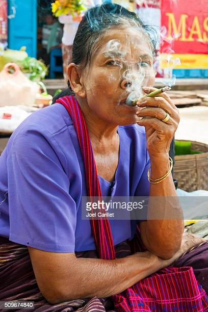 Burmese woman smoking a cheroot