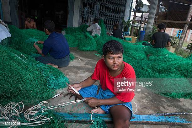Burmese workers make 6000 kyat per day making nets for fishing boats near the planned Dawei SEZ on August 3 2015 in Pantininn Myanmar The...