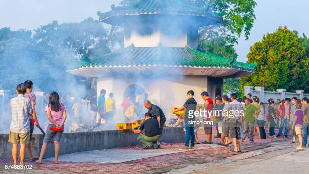 burn offering at qingming festival, malaysia - march month stock photos and pictures