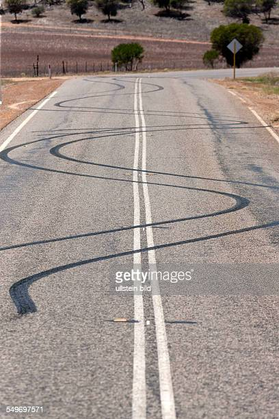 Burn out car tyre marks on road from spiinning wheels Murchison Western Australia