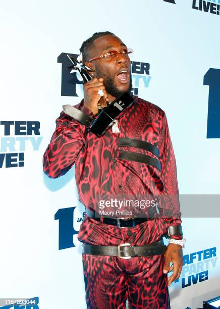 Burna Boy winner of Best International Act poses during the Post Show at the 2019 BET Awards at Microsoft Theater on June 23 2019 in Los Angeles...