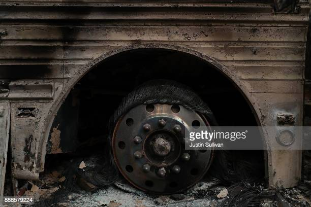 A burned bus sits in a driveway after the Thomas fire burned through the area on December 8 2017 near Ojai California The Thomas fire has burned over...