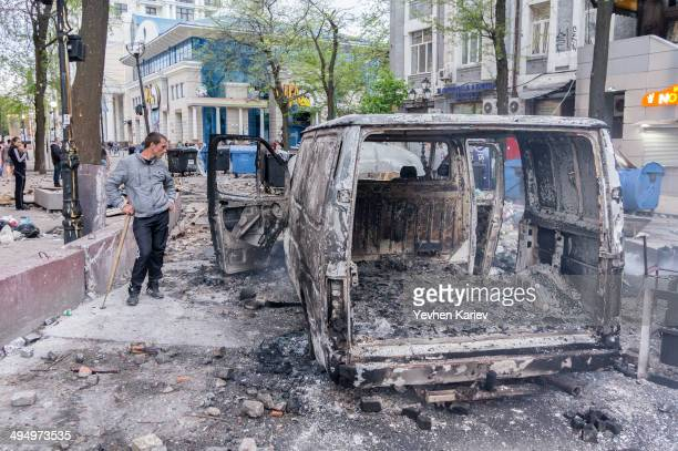 Burned car in Odessa during confrontation between activists of Euromaidan and Antimaidan on 2 of May 2014