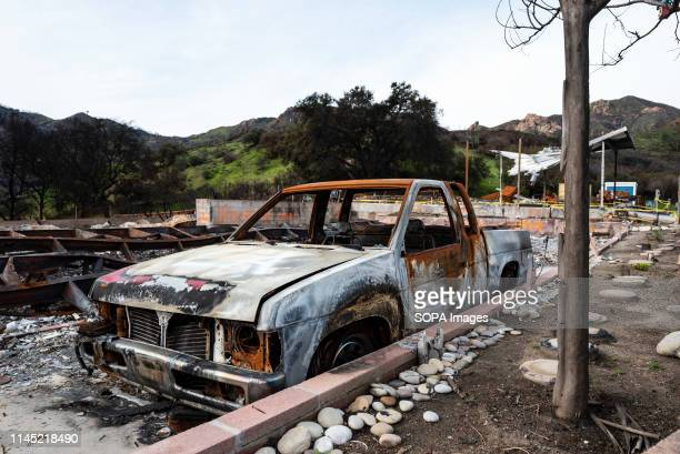 A burned car is seen in the aftermath of the deadly Woolsey wild fire in Agoura Hills California Thousands of fire fighters battled the 2018 Woolsey...