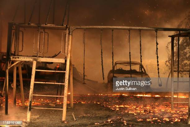 A burned car sits next to a swing after the Kincade Fire moved through the area on October 24 2019 in Geyserville California Fueled by high winds the...