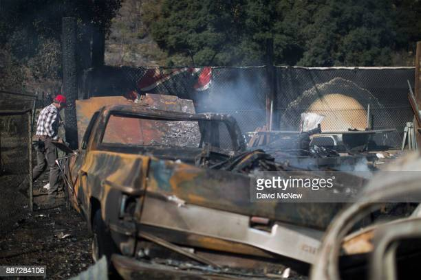 Burned cars and equipment are seen in Little Tujunga Canyon during the Creek Fire on December 6 2017 near Sylmar California Strong Santa Ana winds...