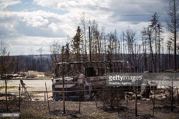 Burned cars and rubble are seen during a wildfire that erupted outside Fort McMurray Alberta Canada on May 11 2016 Wildfire erupted on 3 May...
