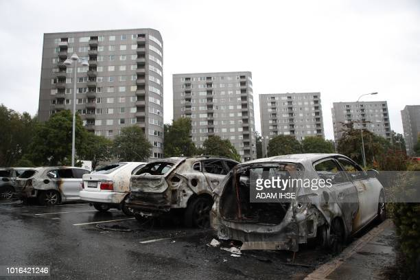 Burned cars are pictured at Froelunda Square in Gothenburg Sweden on August 14 2018 Up to 80 cars have been set on fire in western Sweden by masked...