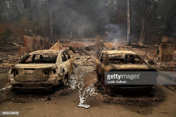 Burned cars sit idle after an out of control wildfire moved through the area on October 9 2017 in Glen Ellen California Tens of thousands of acres...