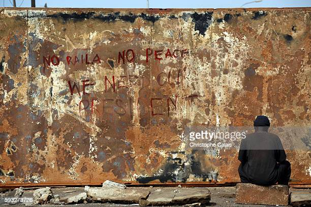 A burned container used to block a road in Kibera bears the handpainted message 'No Raila No Peace We Need Our President'