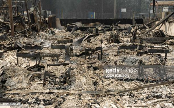 Burned desks sit amidst the burned remains of Berry Creek School during the Bear fire, part of the larger North Lightning Complex fire, in the Berry...