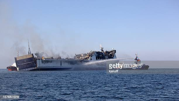 burned ferry - crash stock photos and pictures