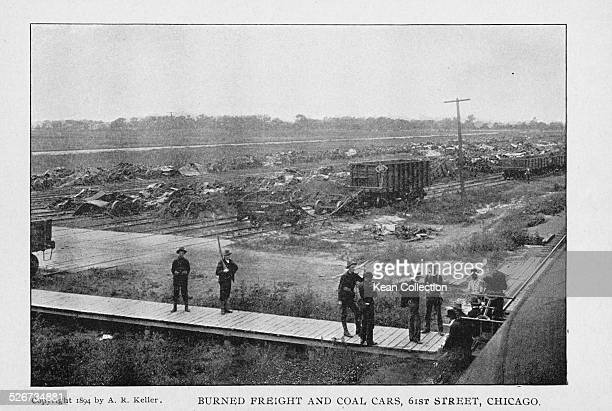 Burned freight and coal cars lining the expanse of the Panhandle Railroad during the Pullman Railway Union Strikes at 61st Street Chicago July 1894...