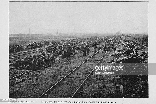 Burned freight cars lining the expanse of the Panhandle Railroad during the Pullman Railway Union Strikes Chicago July 1894 Photograph by A R Keller