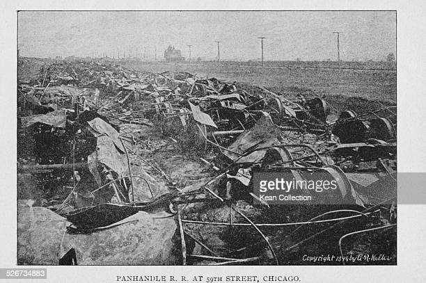 Burned freight cars lining the expanse of the Panhandle Railroad during the Pullman Railway Union Strikes at 59th Street Chicago July 1894 Photograph...