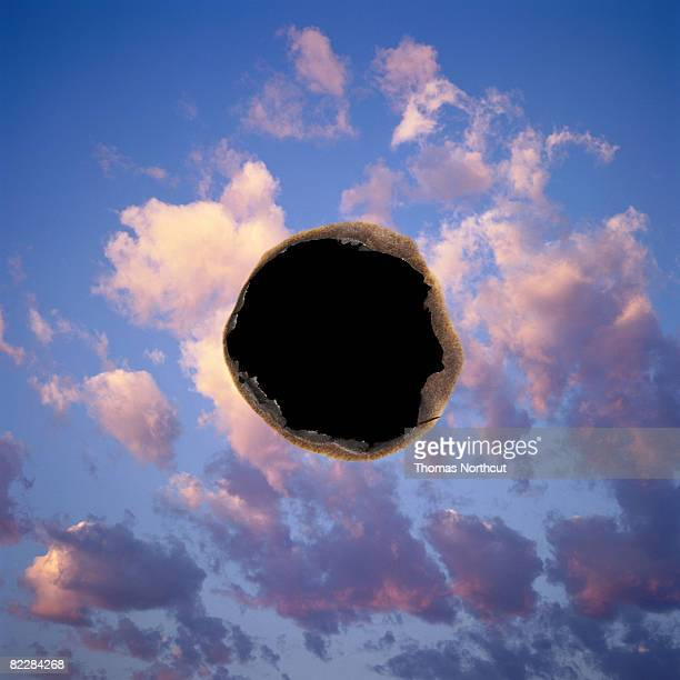 Burned hole in photogaph of sky