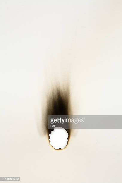 burned hole on a sheet of paper - burnt stock pictures, royalty-free photos & images