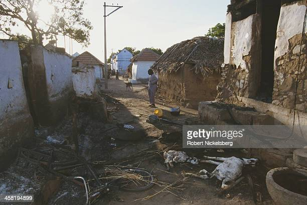 Burned homes in Karisalkulam Tamil Nadu India after a period of violence in which a Dalit man was killed by upper caste militia 1997