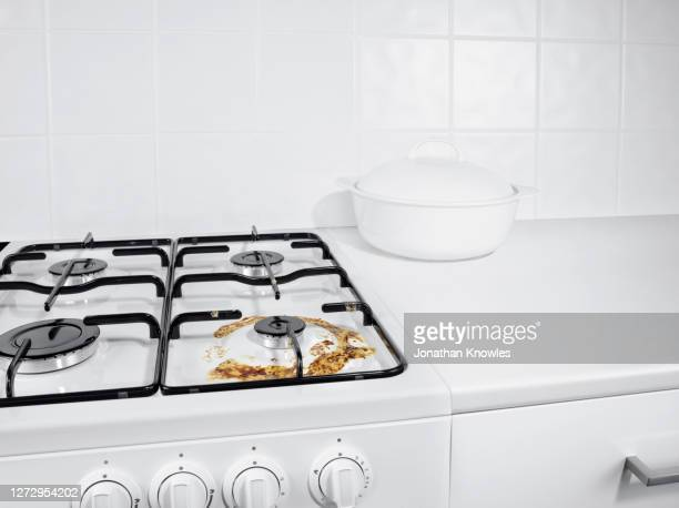 burned milk stain on gas stove - cleaning stock pictures, royalty-free photos & images