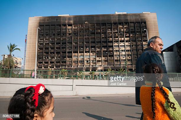 burned ndp party headquarters in cairo, egypt - egyptian culture stock photos and pictures