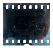 burned or burnt 35mm filmstrip or film material on white background, exposed and black film